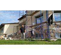 Выравнивание и утепление стен кирпичного дома, декоративная штукатурка и камень White Hills